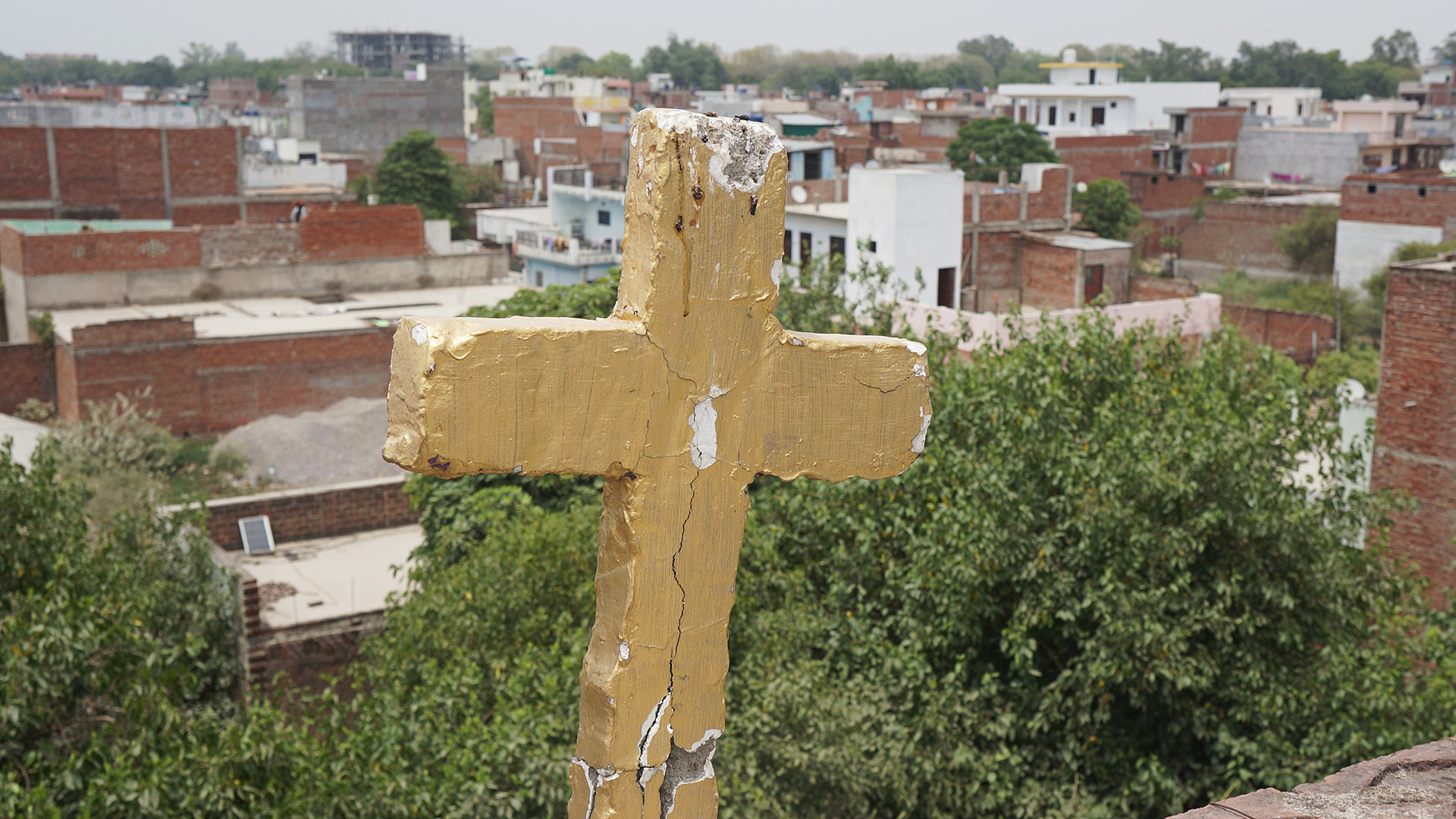 India Cross on a Rooftop