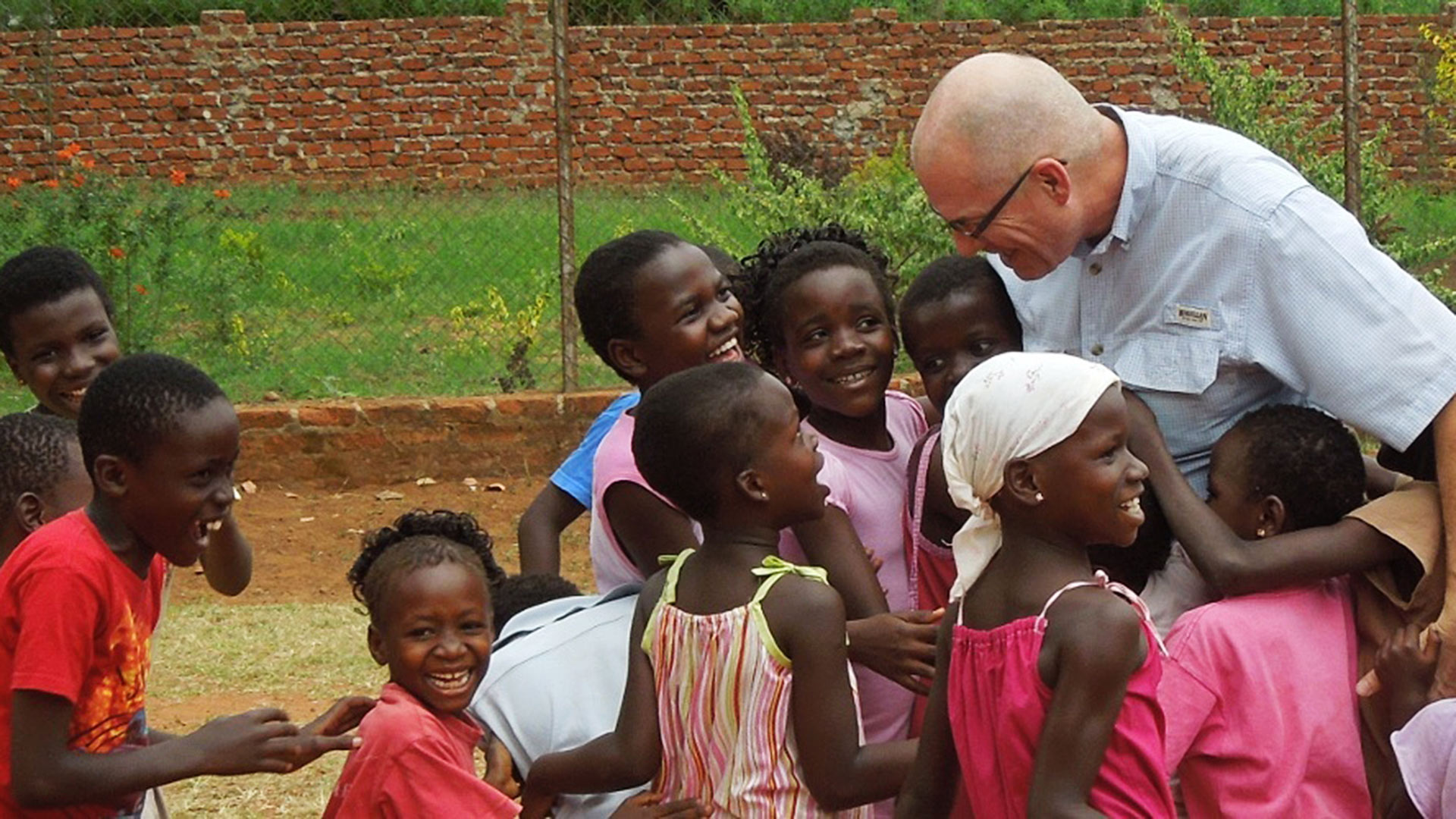 Orphans Heart VP and COO greets children in Uganda