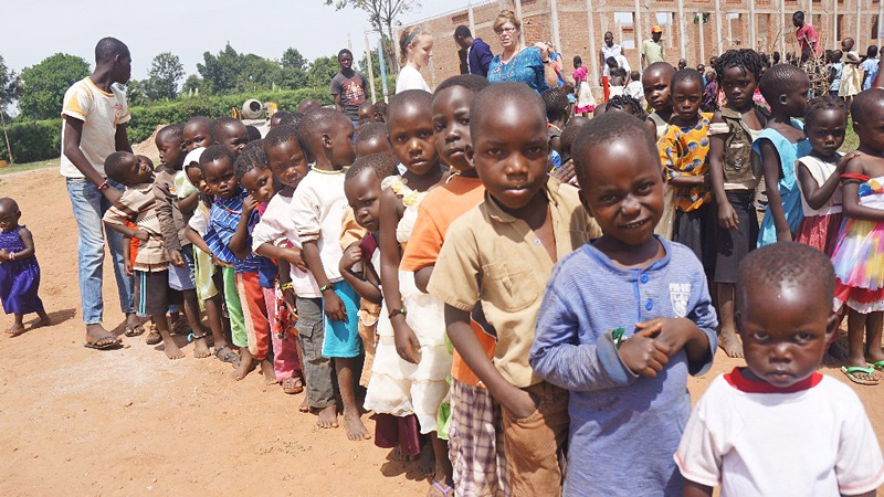 Children wait in line for meal time at the Uganda short term partner mission with All In Ministries and One More Child.