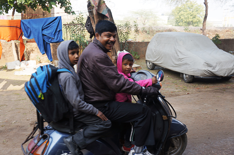 Family in India riding together