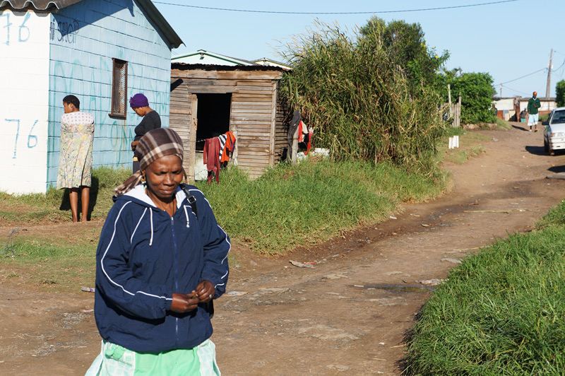 One woman walks on a road in Africa and that's why All In Ministries seeks to help one woman at a time.