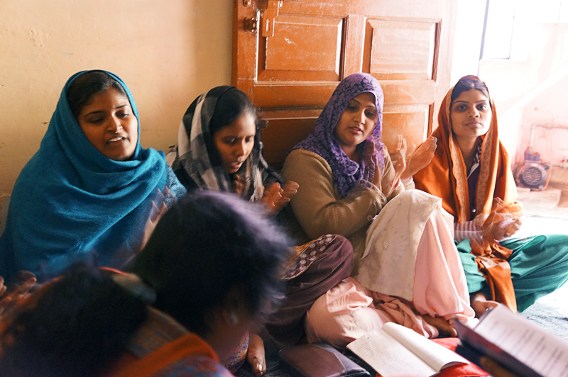 Women in India worshipping and learning about Jesus.