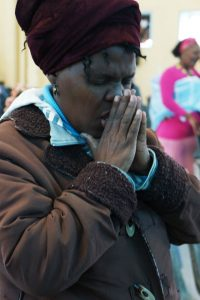 Women prays at the Ethiopia All In Conference