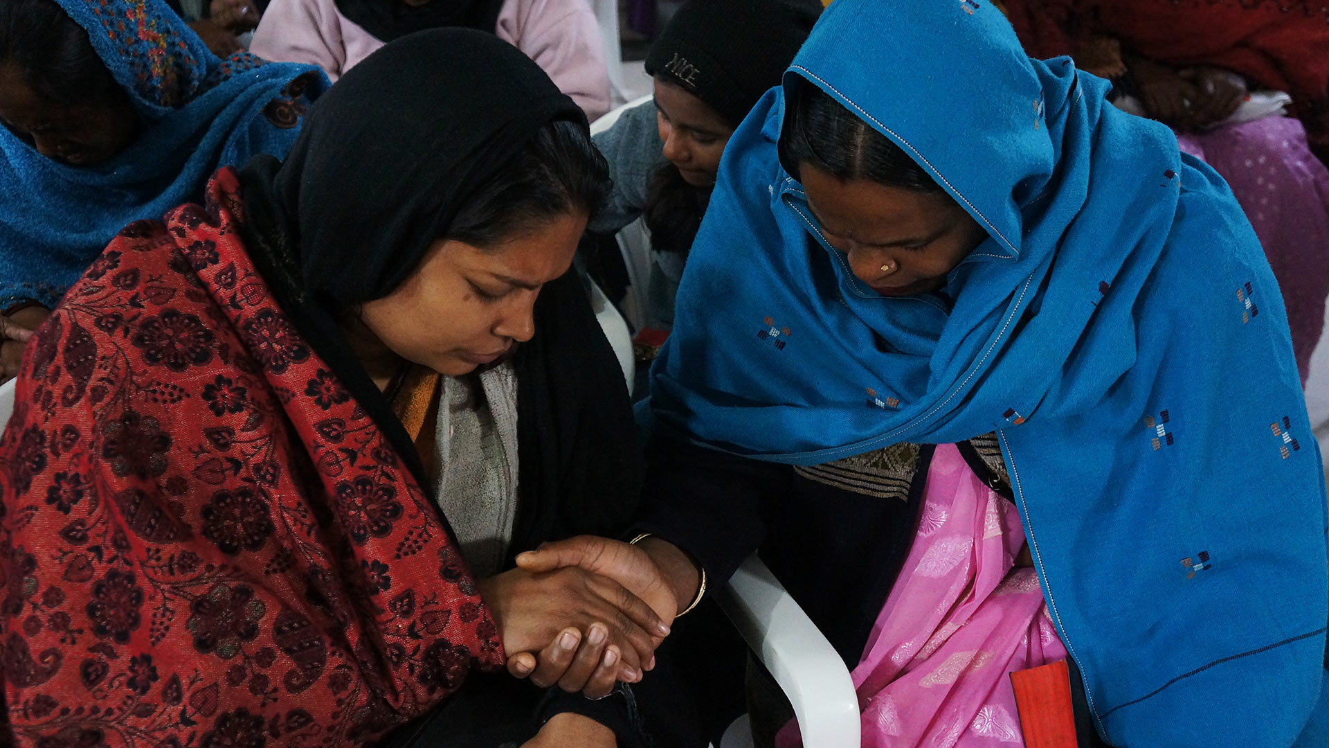 Women praying together and how you can pray for an upcoming mission.