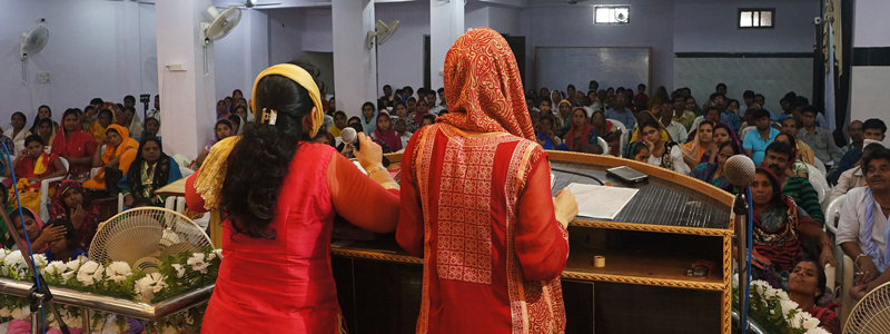 Women learning at the All In India Womens Conference.