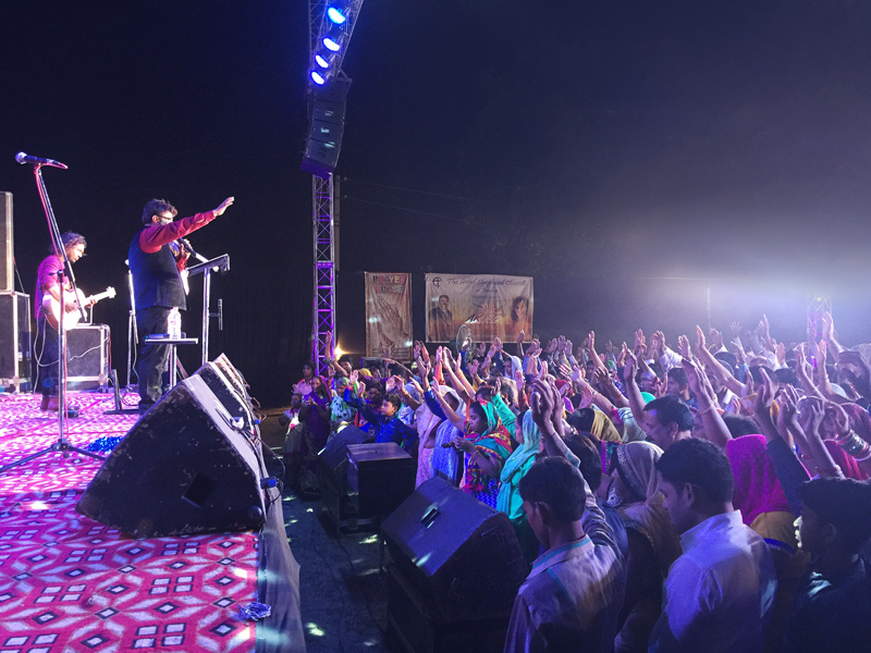 People gather to listen to the Outreach event in India to learn about God's love.