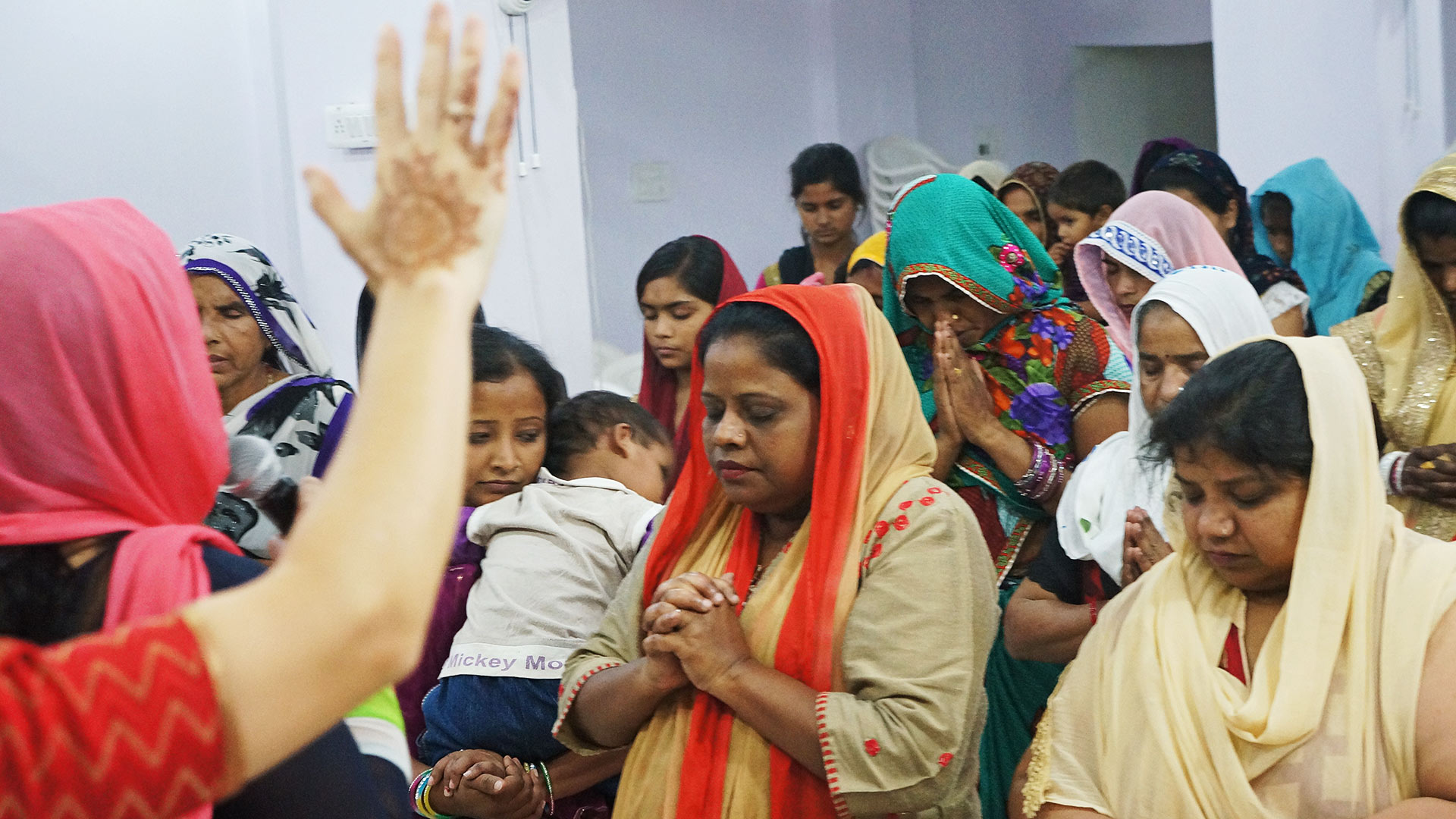Women pray as they learn to be disciple-makers at the India All In Ministries Conference