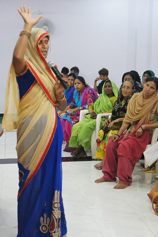 A blind woman giving her testimony at the All In Womens Conference in India.
