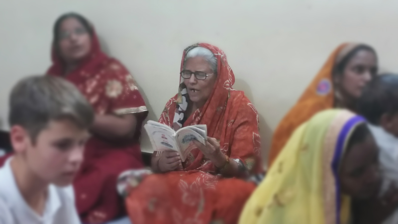 Older woman learns about God's love at the All In Womens Conference in India.