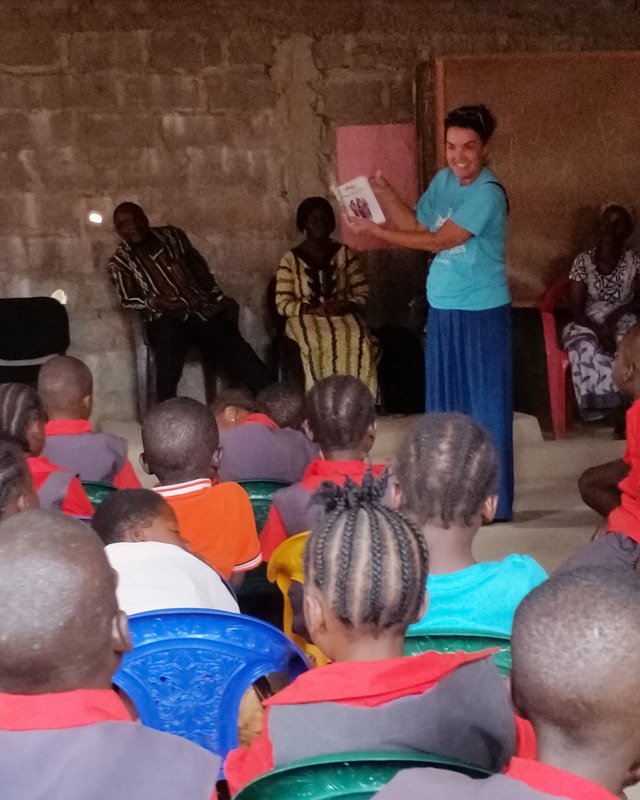 One of the teachers tells the Easter story to the children in Liberia.