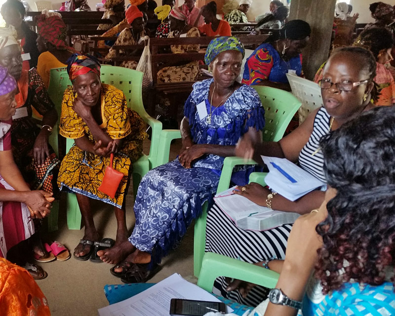 Women in Bible study at the All In Liberian Womens Conference