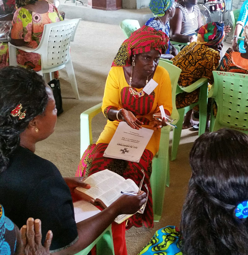 Women in group discussion at the All In Womens Conference in Liberia