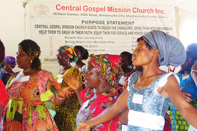 Women worship at the All In Conference in Liberia