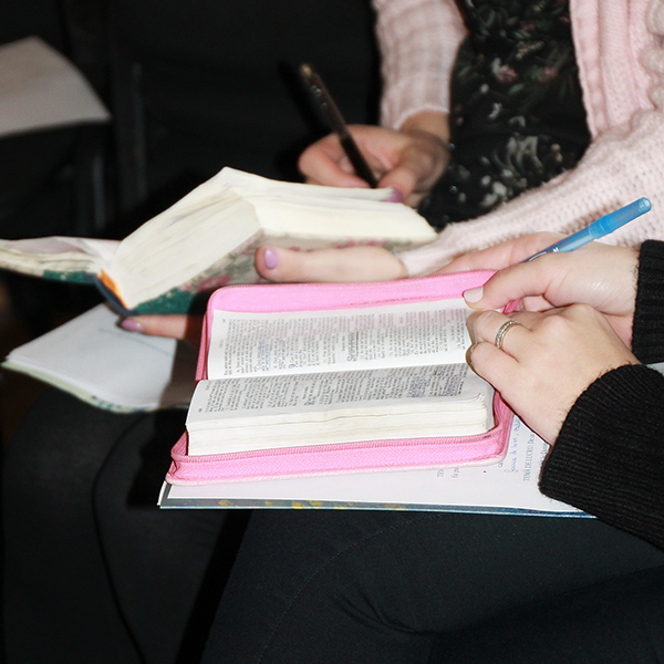 Turning Your Tears Into Pearls for Others - The Power of Testimonies Romania Conference Women making notes in their Study Bibles