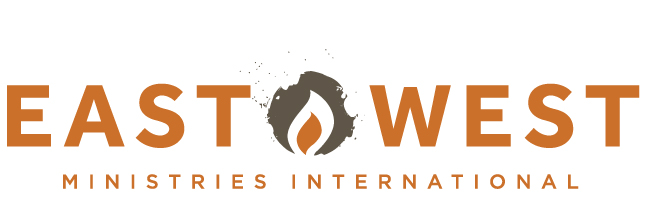 east west Missions Logo