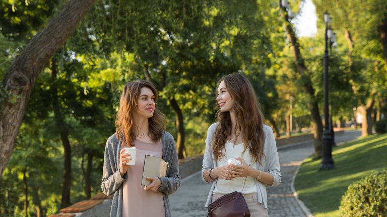 How to Share Your Testimony Women Walk Together in Park with Coffee