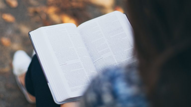 How to Study the Bible for Beginners — woman studies her Bible.